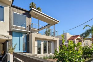 modern front of home with stucco and shou sugi ban exterior
